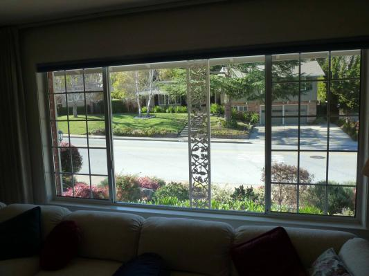 Large front window with two sliders