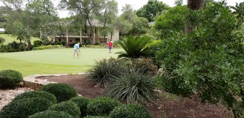 Beautiful landscaping all around .. even by the putting green.
