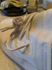 Close up of the lace showing how it doesn't go into the shoe itself